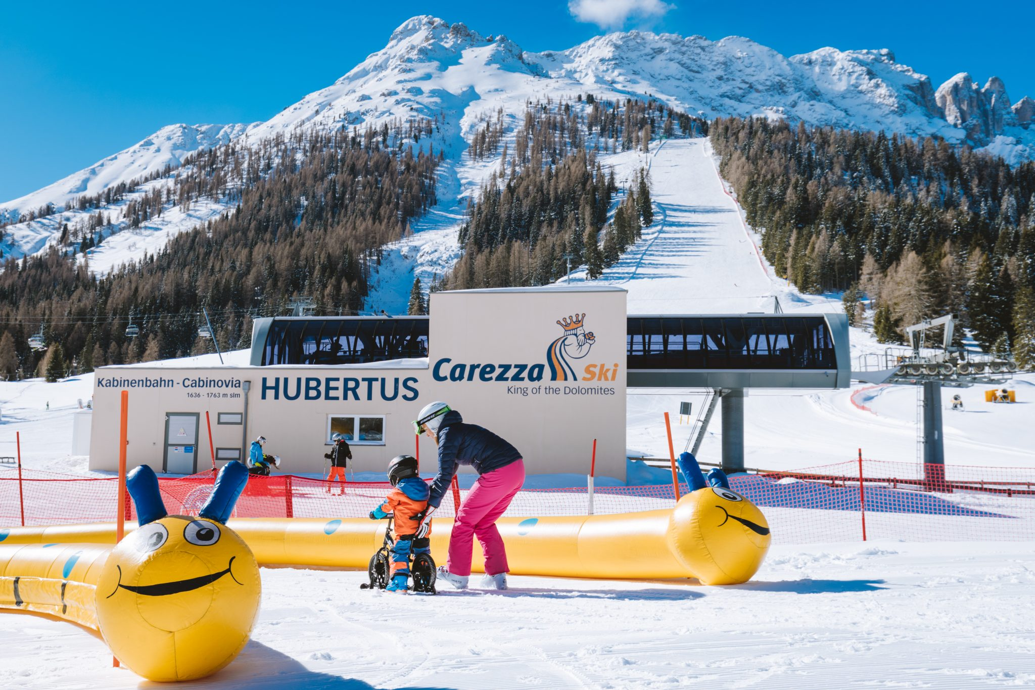 day-long assistance to children during the Dolomites skiing week for kids in Carezza, Dolomites